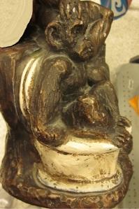 Statue full of monkeys side view