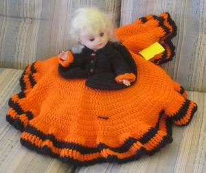 Orange bed doll