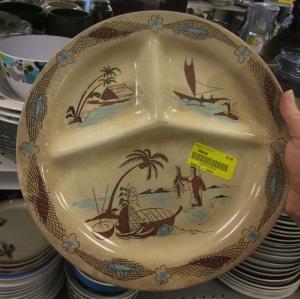 This cool tiki plate has had a hard life