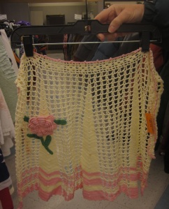 Crochet apron with rose