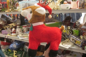 Rudolph the Green Nose Reindeer in a Santa Suit or flannel pajamas