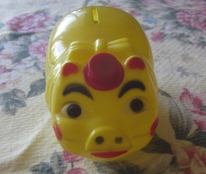 Hat tipping piggy bank