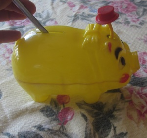 Piggy Bank tipping his hat