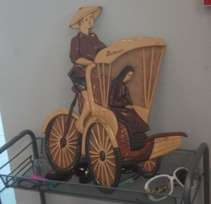 Strange wooden pedal car
