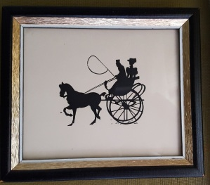 Black cut silhouette of regency couple in curicle